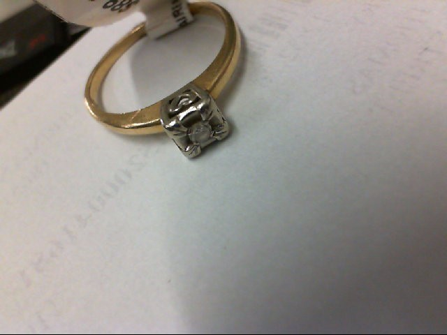 Lady's Diamond Solitaire Ring .01 CT. 14K Yellow Gold 1.7g