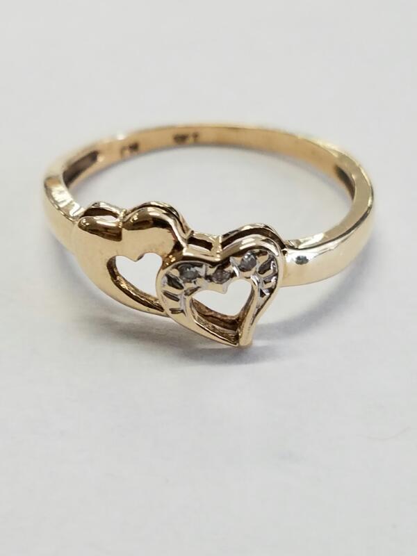 Lady's Diamond Fashion Ring 3 Diamonds .12 Carat T.W. 10K Yellow Gold 1.71g