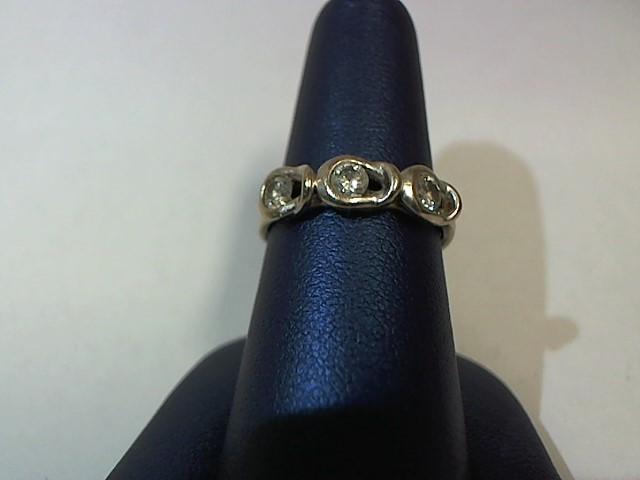 Lady's Diamond Fashion Ring 3 Diamonds .24 Carat T.W. 10K White Gold 3.4g