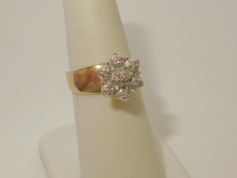 Lady's Diamond Fashion Ring 7 Diamonds .035 Carat T.W. 10K Yellow Gold 3.7g