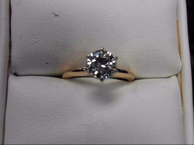 Lady's Diamond Solitaire Ring .84 CT. 14K Yellow Gold 2.54g Size:6