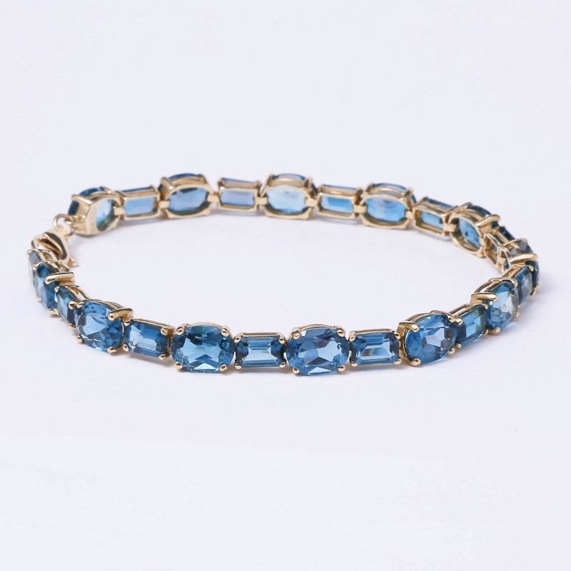"7"" 10K Yellow Gold Blue Topaz Bracelet"