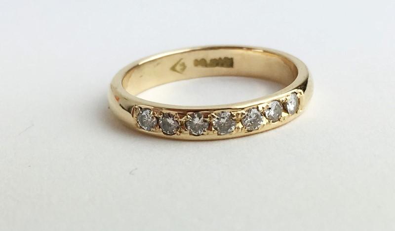 Lady's Diamond Fashion Ring 7 Diamonds .21 Carat T.W. 737 Yellow Gold 3.06g