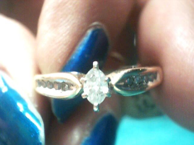 Lady's Diamond Solitaire Ring 13 Diamonds .15 Carat T.W. 14K Yellow Gold 1.9dwt