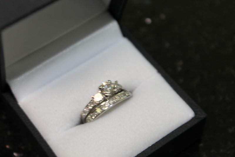 Lady's 14k white gold 1/2 round/princess cut diamonds, eternity band size 4