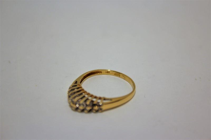 Lady's Diamond Fashion Ring 18 Diamonds .18 Carat T.W. 14K Yellow Gold 1.9g
