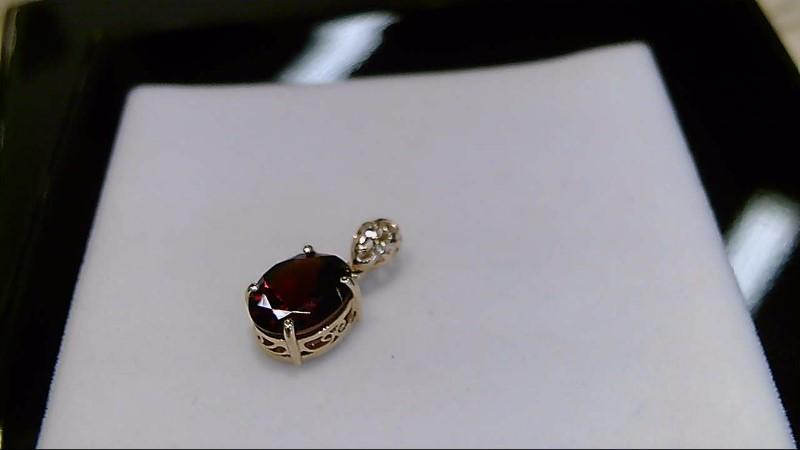 Lady's 10k yellow gold oval garnet pendant