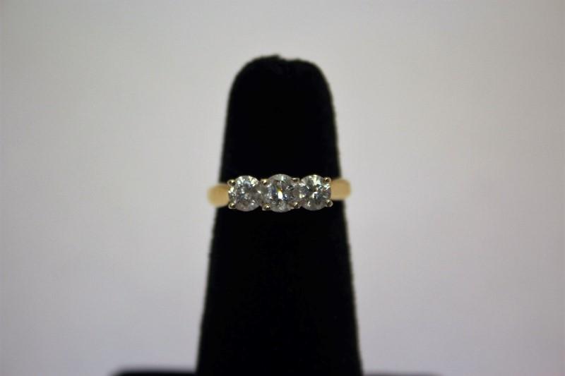 Lady's Diamond Fashion Ring 3 Diamonds 1.05 Carat T.W. 14K Yellow Gold 3.3g