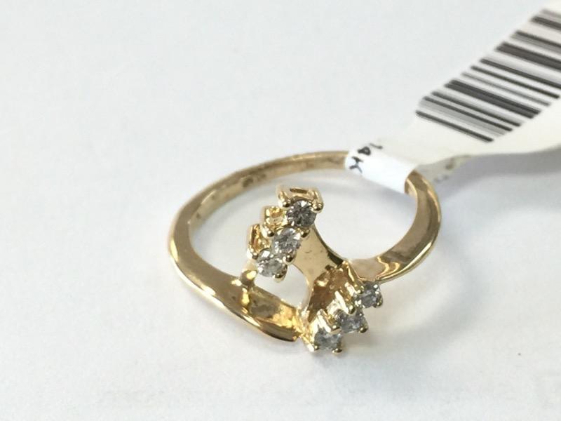 Lady's Diamond Wedding Band 6 Diamonds .12 Carat T.W. 14K Yellow Gold 1.2dwt