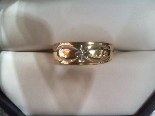 Lady's Diamond Wedding Band .01 CT. 14K Yellow Gold 4.3g
