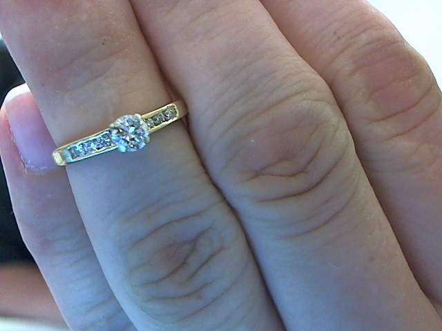 Lady's Diamond Solitaire Ring 7 Diamonds .28 Carat T.W. 14K Yellow Gold 2.1g