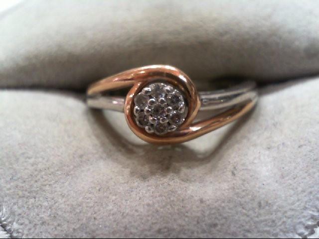 Lady's Silver-Diamond Ring 7 Diamonds .07 Carat T.W. 925 Silver 2.8g