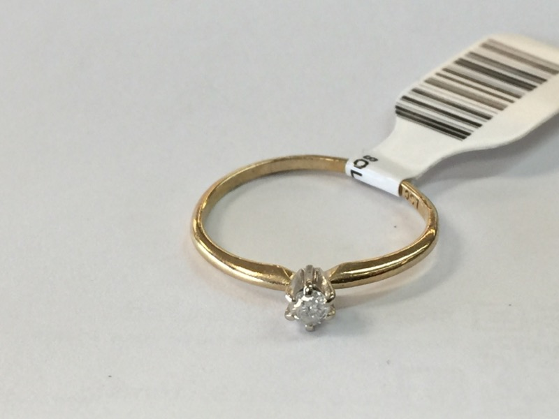 Lady's Diamond Solitaire Ring .05 CT. 10K Yellow Gold 0.7dwt Size:7