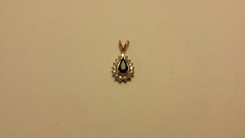 14k Yellow Gold Pendant with 1 Pear Blue Stones and 15 Diamonds at .15ctw