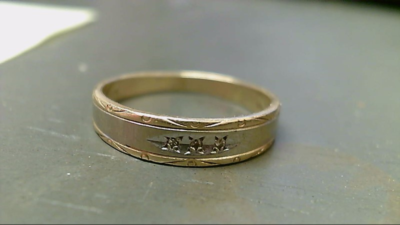 Lady's Diamond Wedding Band 3 Diamonds .015 Carat T.W. 14K 2 Tone Gold 3.1g