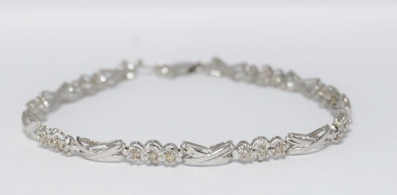 """7"""" 10K White Gold 3-Stone X O Style Diamond Tennis Bracelet"""