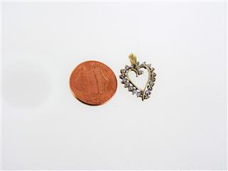 10 KT GOLD PENDANT HEART 0.9DWT/YG