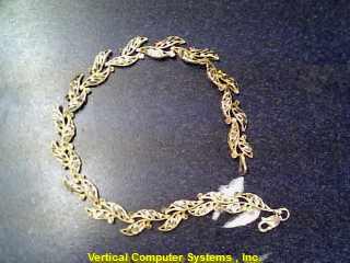 Gold Fashion Bracelet LEAVES_BANDED_TOGETHER 10K Yellow Gold 3.3dwt
