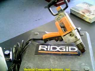 R7120 DRILL RIDGID  PW IV ID # 3216 / CORDED ORG.BLK