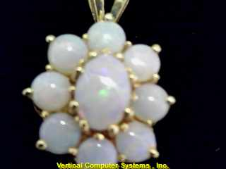MOONSTONE CHARM 14KT  SHAPLE LIKE A FLOWER, PW 2343 1.4/YG