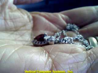 RED STONE(S)  CHAIN AND CHARM 9KT RED STONE(S) THE CHAIN IS 9 K WG, WITH SILVER