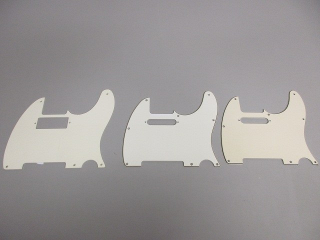 LOT OF THREE (3) WHITE TELECASTER PICKGUARDS