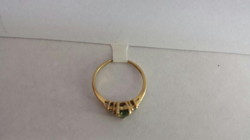 10k Yellow Gold Ring with 1 Green Heart and 2 Diamonds