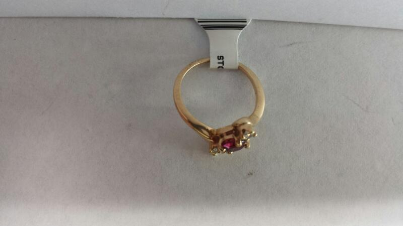10k Yellow Gold Ring with 1 Red Stone and 2 Diamond Chips