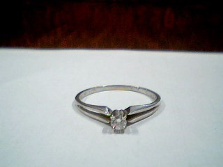 Lady's Diamond Solitaire Ring .06 CT. 14K White Gold 1.3g Size:6.8