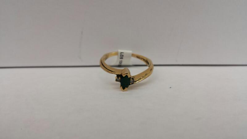 10k Yellow Gold Ring with 1 Green Stone and2 Diamond Chips