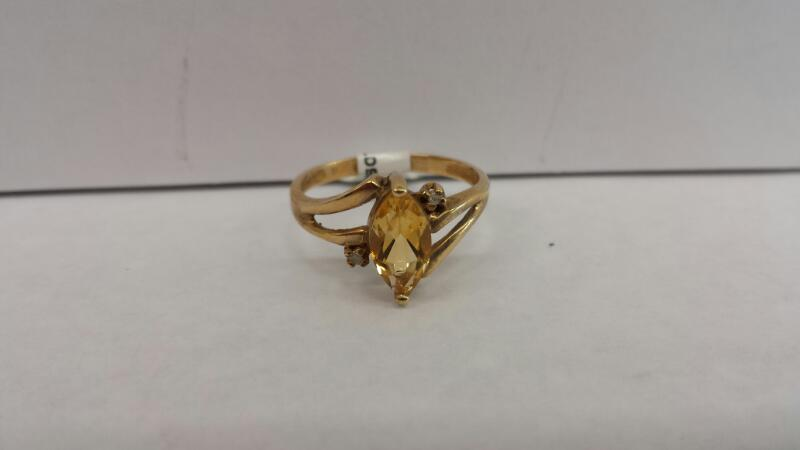 10k Yellow Gold Ring with a Yellow Stone and 2 Diamond Chips