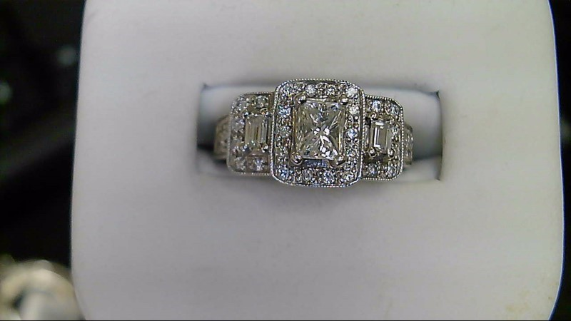 ESTATE WG .48CT (H-SI2) EMERALD CUT CENTER WITH 2-.20CT EMERAD CUT SIDE WITH ROU