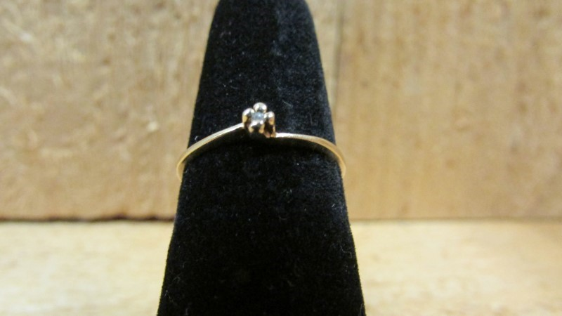 Lady's Diamond Solitaire Ring .01 CT. 10K Yellow Gold 0.8g Size:6.5