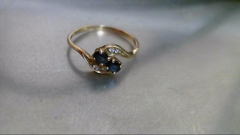 Sapphire Lady's Stone & Diamond Ring 4 Diamonds .032 Carat T.W. 14K Yellow Gold