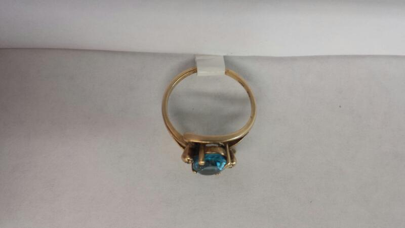10k Yellow Gold Ring with Oval Blue Stone and 2 Diamond Chips