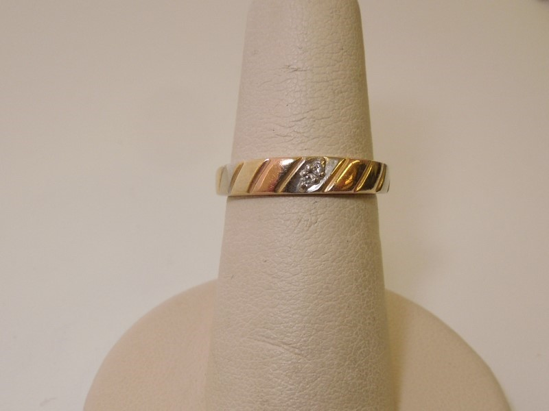 Lady's Diamond Wedding Band 2 Diamonds .02 Carat T.W. 14K Tri-color Gold 2.3g