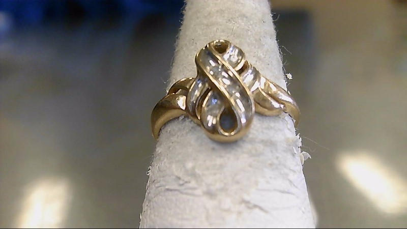 Lady's Diamond Fashion Ring 4 Diamonds .12 Carat T.W. 10K Yellow Gold 2.2g