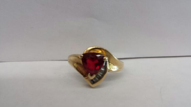 10k Yellow Gold Ring with 1 Red stone and 5 Baguette Stones