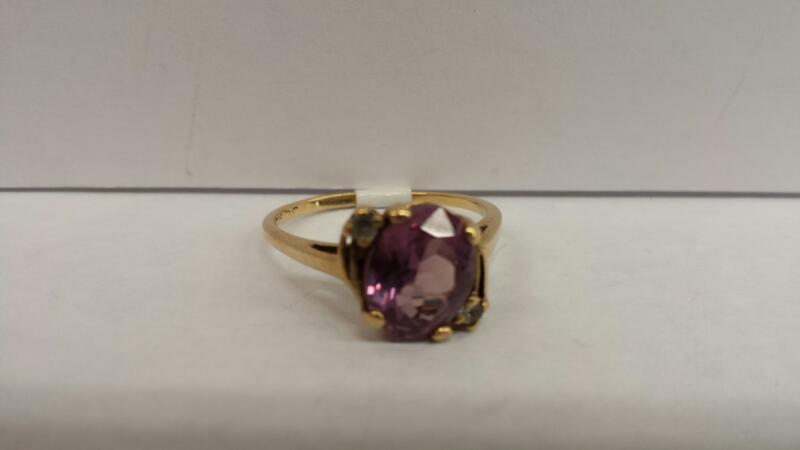 10k Yellow Gold Stone with 1 Purple Stone and 2 Diamond Chips