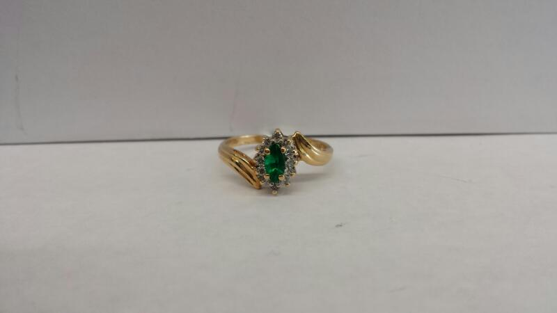 14k Yellow Gold Ring with 1 Green Stone and 12 Diamond Chips