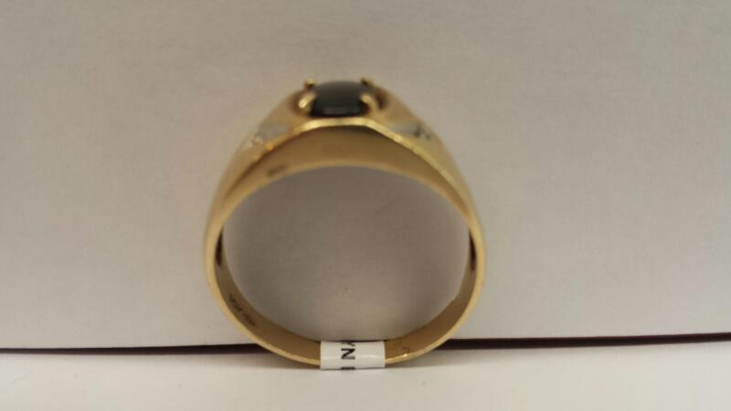 10k Yellow Gold Ring with 1 Oval Cats-eye stone and 2 Diamond Chips