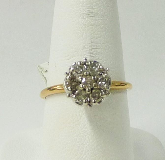 Lady's Diamond Cluster Ring 7 Diamonds .56 Carat T.W. 10K Yellow Gold 1.65dwt