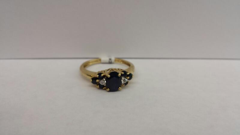 14k Yellow Gold Ring with 7 Blue Stones and 2 Diamond Chips