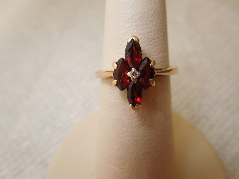 Synthetic Almandite Garnet Lady's Stone & Diamond Ring .01 CT. 10K Yellow Gold