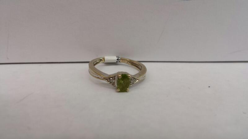 10k White Gold Ring with 1 Green Stone and 2 Diamond Chips