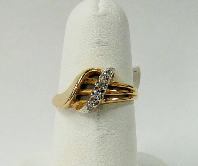 Lady's Diamond Fashion Ring 4 Diamonds .08 Carat T.W. 10K Yellow Gold 1.6dwt
