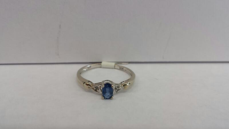 10k White Gold RIng with 1 Blue Stone and 2 Diamond Chips