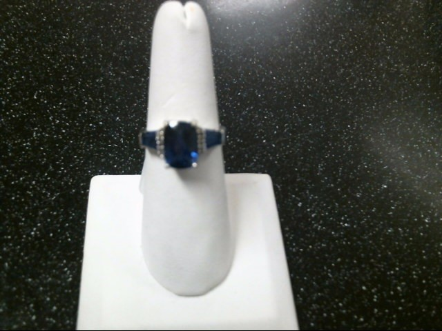 Blue Stone Lady's Stone & Diamond Ring 4 Diamonds .08 Carat T.W. 10K White Gold