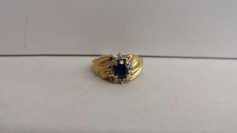 10k Yellow Gold Ring with 1 Blue Stone and 12 Diamond Chips