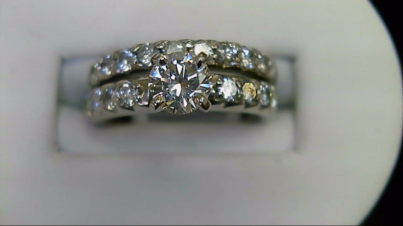 Lady's 14k white gold 1/2ct round center with round diamonds in mounting